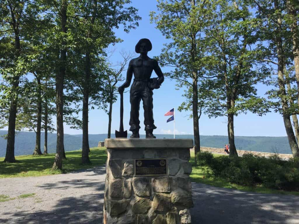 forest fire warden statue in hyner view
