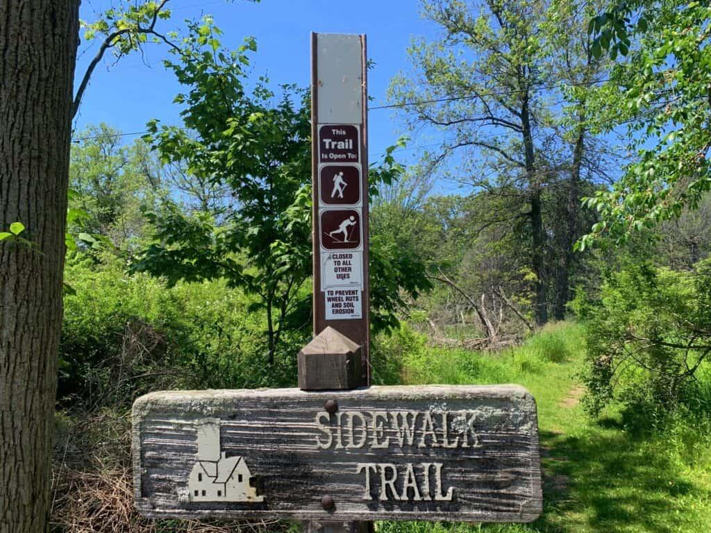 presque isle state park sidewalk trail sign